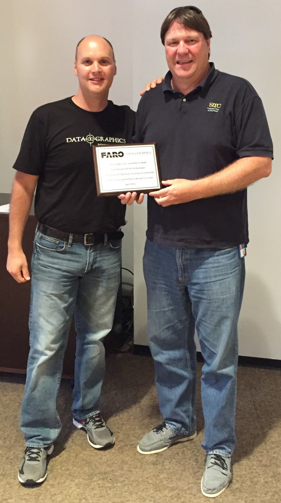 CEO Brad Presenting a plaque honoring our host with the most, Tom. Thanks again for everything, Tom and the Faro Team.